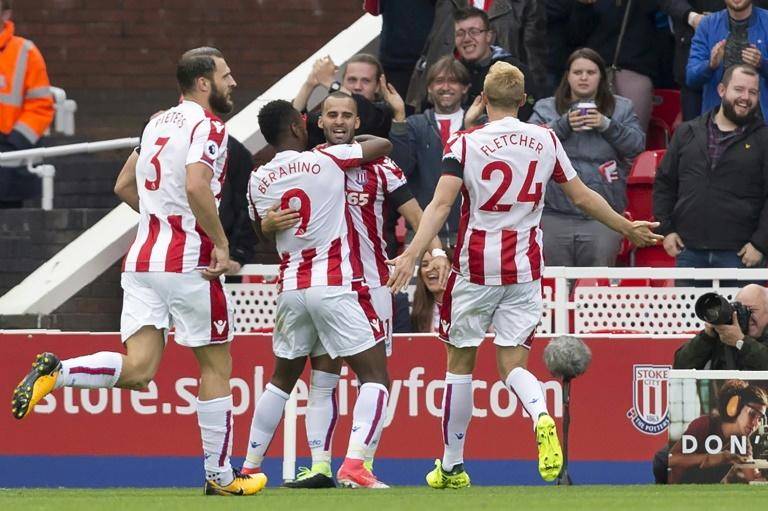 Stoke City's Jese (C) celebrates with teammates after scoring a goal during their English Premier League match against Arsenal, at the Bet365 Stadium in Stoke-on-Trent, on August 19, 2017