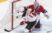 New Jersey Devils' Nico Hischier scores against Montreal Canadiens goaltender Keith Kinkaid during the second period of an NHL hockey game in Montreal, Saturday, Nov. 16, 2019. (Graham Hughes/The Canadian Press via AP)