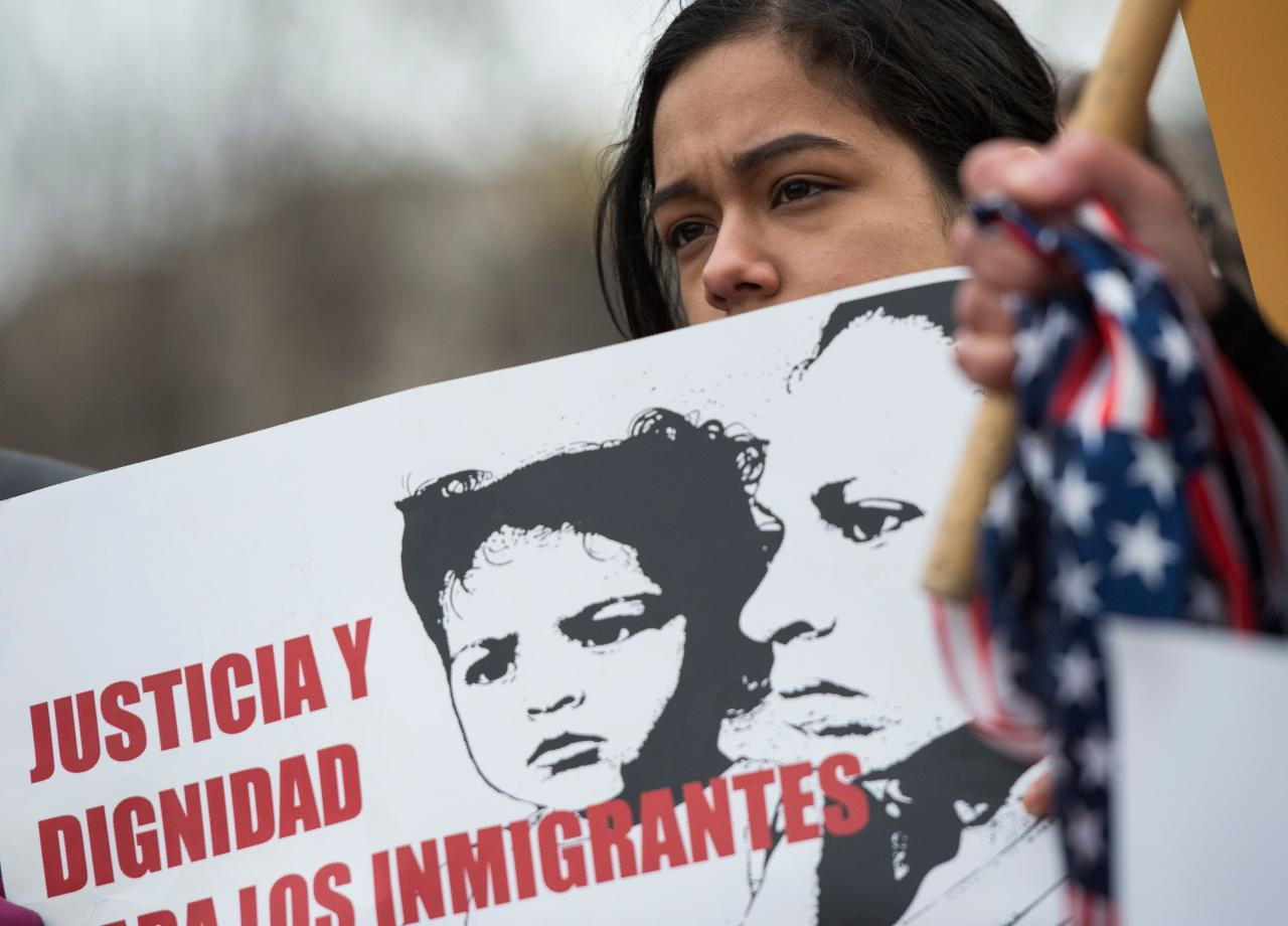 <p>A young girl looks on as other immigrants and activists protest near the White House to demand that the Department of Homeland Security extend Temporary Protected Status (TPS) for more than 195,000 Salvadorans on Jan. 8, 2018 in Washington. (Photo: Andrew Caballero-Reynolds/AFP/Getty Images) </p>
