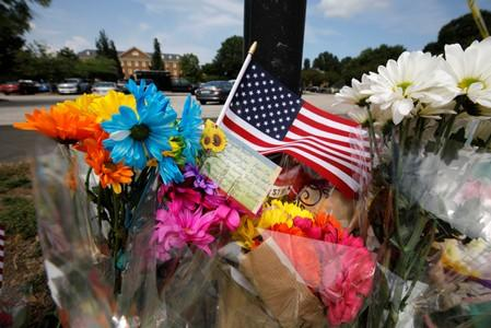 A card lists the names of the victims at a makeshift memorial outside a municipal government building where a shooting incident occurred in Virginia Beach, Virginia