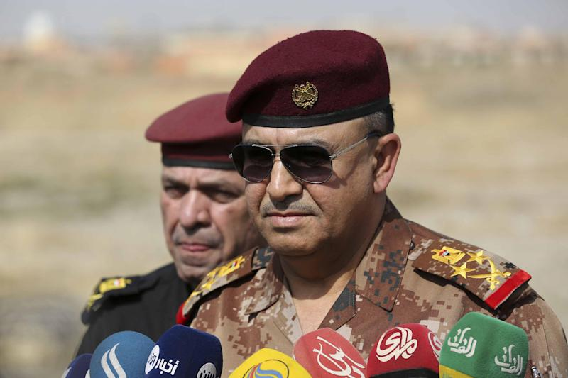 FILE - In this Wednesday, Oct. 19, 2016, file photo, the Commander of the Joint Military Operation Commander, Army Lt. Gen. Talib Shaghati, speaks with the media in the town of Khazer, Iraq. The top Iraqi commander says the operation to retake the city of Mosul from the Islamic State group could be complete in three months or less. Shaghati warns it is difficult to give an accurate estimate of how long the operation will take because it is not a conventional fight. (AP Photo/Khalid Mohammed, File)