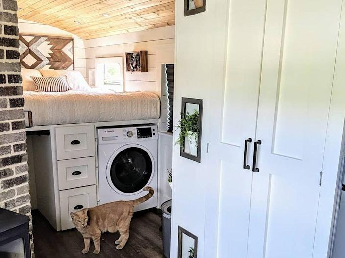 Couple Converts School Bus Into Mobile Home to Travel with Their Cat