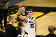 FILE - Iowa center Luka Garza (55) reacts during a video tribute following an NCAA college basketball game against Penn State in Iowa City, Iowa, in this Sunday, Feb. 21, 2021, file photo. Garza has made The Associated Press All-America first team, announced Tuesday, March 16, 2021. (AP Photo/Charlie Neibergall, File)