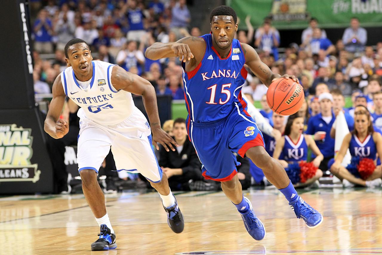 Elijah Johnson #15 of the Kansas Jayhawks drives on Marquis Teague #25 of the Kentucky Wildcats in the first half in the National Championship Game of the 2012 NCAA Division I Men's Basketball Tournament at the Mercedes-Benz Superdome on April 2, 2012 in New Orleans, Louisiana. (Photo by Jeff Gross/Getty Images)