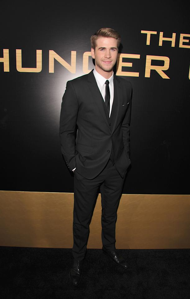 "Liam Hemsworth arrives at the world premiere of ""The Hunger Games"" in Los Angeles, California."