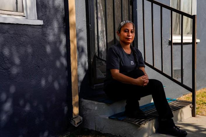 LOS ANGELES, CA - JULY 30: Lizett Aguilar poses for a portrait outside of her home in East Los Angeles on Thursday, July 30, 2020 in Los Angeles, CA. Aguilar said that after she helped lead strikes at a Domino's in Boyle Heights over unsafe working conditions, her supervisor retaliated against her by making her job more onerous. (Kent Nishimura / Los Angeles Times)