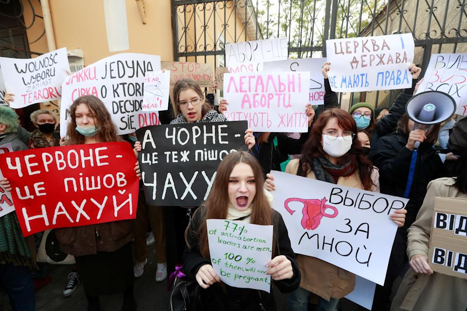 SENSITIVE MATERIAL. THIS IMAGE MAY OFFEND OR DISTURB People attend a rally in support of Polish demonstrators protesting against imposing further restrictions on abortion law, outside the Polish embassy in Kyiv, Ukraine October 26, 2020. REUTERS/Valentyn Ogirenko