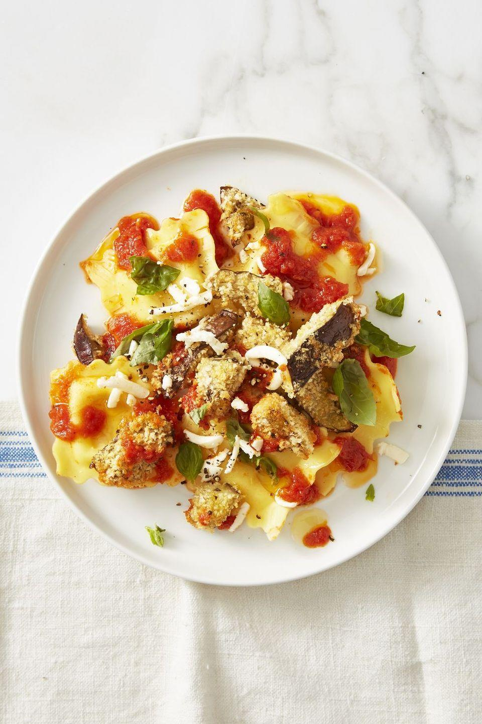 """<p>Air fry breaded eggplant slices to top off store-bought ravioli. Easy!</p><p><em><a href=""""https://www.goodhousekeeping.com/food-recipes/easy/a45682/speedy-eggplant-parmesan-recipe/"""" rel=""""nofollow noopener"""" target=""""_blank"""" data-ylk=""""slk:Get the recipe for Speedy Eggplant Parmesan »"""" class=""""link rapid-noclick-resp"""">Get the recipe for Speedy Eggplant Parmesan »</a></em></p>"""