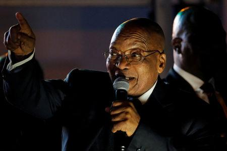 FILE PHOTO: South Africa's President Jacob Zuma celebrates with his supporters after he survived a no-confidence motion in parliament in Cape Town, South Africa, August 8, 2017.   REUTERS/Mike Hutchings/File Photo