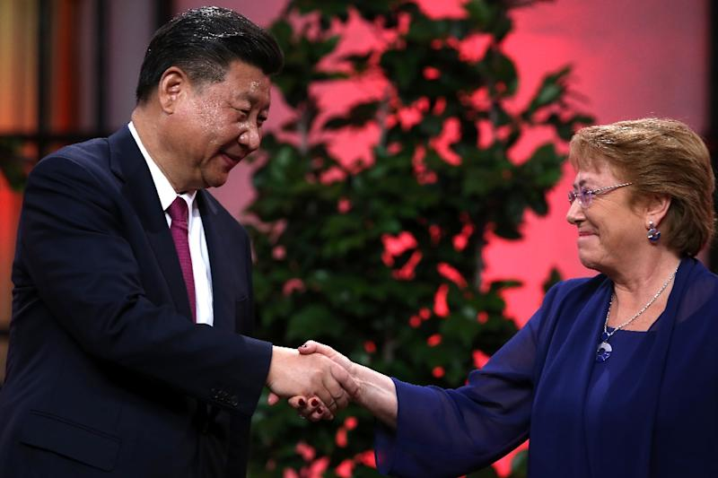 The two countries agreed on trade the move during a visit by Chinese President Xi Jinping (L) to Chile last year, where he is seen with Chilean President Michelle Bachelet (R)