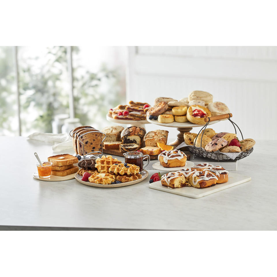 """<p>Want to surprise your mom (or someone else you love) with breakfast in bed... but you can't cook? Don't worry, <span>Wolferman's Bakery</span> has got your back — especially with this scrumptious set that lets you choose from an assortment of sweet treats. </p> <p><strong>$44.99, <a href=""""https://go.skimresources.com/?id=58287X1516327&xs=1&url=https%3A%2F%2Fwww.wolfermans.com%2Fw%2Fmuffins-breads%2Fbreads-samplers%2F8205&xcust=EWMothersDayGiftGuideBKaplan0421"""" rel=""""nofollow noopener"""" target=""""_blank"""" data-ylk=""""slk:wolfermans.com"""" class=""""link rapid-noclick-resp"""">wolfermans.com</a></strong></p>"""