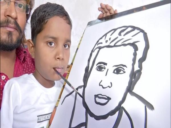 Boy paints with his mouth (ANI)