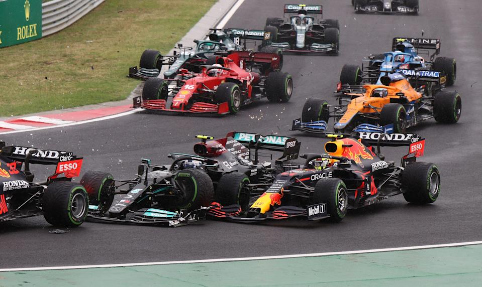 Bottas (front-centre) collides with Perez (front-right) (POOL/AFP via Getty Images)