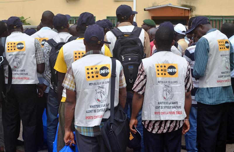 A group of Guinean sanitation control agents prepare to leave as reinforcements for the provinces infected by Ebola, August 20, 2014 in Conakry (AFP Photo/Cellou Binani)