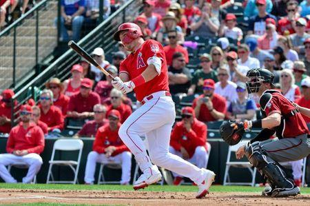 FILE PHOTO: Mar 15, 2019; Tempe, AZ, USA; Los Angeles Angels center fielder Mike Trout (27) singles in the first inning against the Arizona Diamondbacks at Tempe Diablo Stadium. Mandatory Credit: Matt Kartozian-USA TODAY Sports