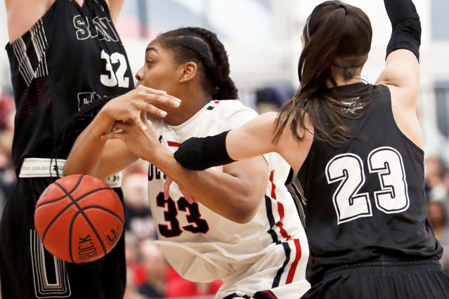 St. Francis (Pa)'s Jessica Kovatch (23) knocks the ball from Robert Morris' Nneka Ezeigbo (33) who was driving to the hoop during the first half of an NCAA college basketball game for the championship of the Northeast Conference women's tournament, Sunday, March 17, 2019, in Moon, Pa. (AP Photo/Keith Srakocic)