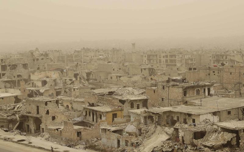 A picture taken during a sandstorm shows destruction in the once rebel-held Karm al-Jabal neighbourhood in the northern city of Aleppo