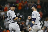 Seattle Mariners' Ichiro Suzuki, left, fist-bumps teammate Mitch Haniger after a baseball game against the Baltimore Orioles, Wednesday, June 27, 2018, in Baltimore. Seattle won 8-7 in 11 innings. (AP Photo/Patrick Semansky)