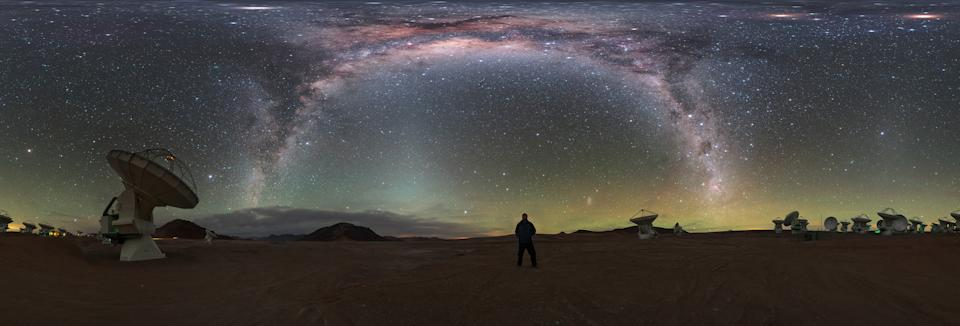 Surrounded by telescopes, European Southern Observatory photo ambassador Petr Horálek basks in the light of the Milky Way galaxy in this cosmic selfie. The panoramic image shows Horálek standing among the many antennas that make up the Atacama Large Millimeter/submillimeter Array (ALMA) in the Atacama Desert in Chile.