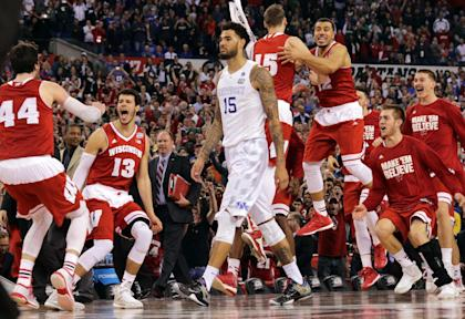 Wisconsin bench celebrates as Kentucky's Willie Cauley-Stein walks off after the loss. (AP)