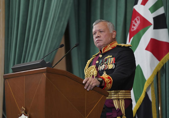 """FILE - In this Dec. 10, 2020 file photo released by the Royal Hashemite Court, Jordan's King Abdullah II gives a speech during the inauguration of the 19th Parliament's non-ordinary session, in Amman Jordan. Jordan's king addressed the public feud with his half-brother, Prince Hamzah, portraying it as an attempted """"sedition"""" that caused him shock, anger and pain. The statement on Wednesday, April 7, 2021, carried by Jordan TV, marked the first time King Abdullah II addressed the unprecedented rift in the royal family which erupted over the weekend. (Yousef Allan/The Royal Hashemite Court via AP, File)"""