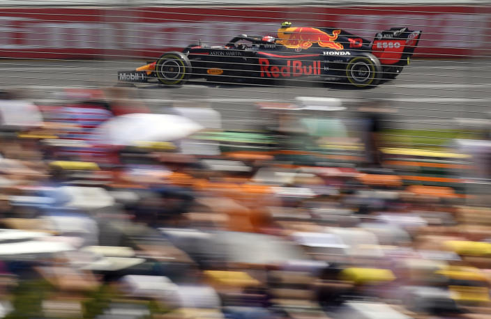 In this March 16, 2019, file photo, Red Bull driver Pierre Gasly of France races past the crowd during the third practice session for the Australian Grand Prix in Melbourne, Australia. The start of the 2021 Formula One season has been delayed after the Australian Grand Prix was postponed because of the coronavirus pandemic. The Australian race in Melbourne has been rescheduled from March 21 to November 21. (AP Photo/Andy Brownbill, File)
