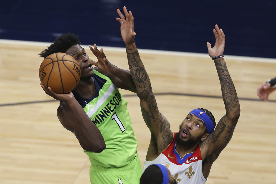Minnesota Timberwolves' Anthony Edwards (1) goes up to the basket against New Orleans Pelicans' Brandon Ingram during the second half of an NBA basketball game Saturday, May 1, 2021, in Minneapolis. (AP Photo/Stacy Bengs)