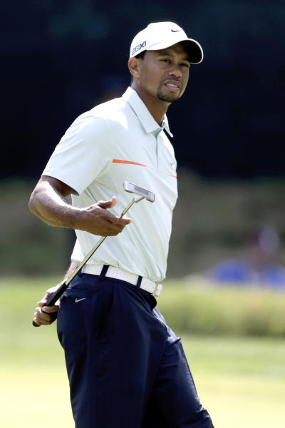 Tiger Woods reacts to a putt on the sixth hole during the third round of the U.S. Open golf tournament at Merion Golf Club, Saturday, June 15, 2013, in Ardmore, Pa. (AP Photo/Darron Cummings)
