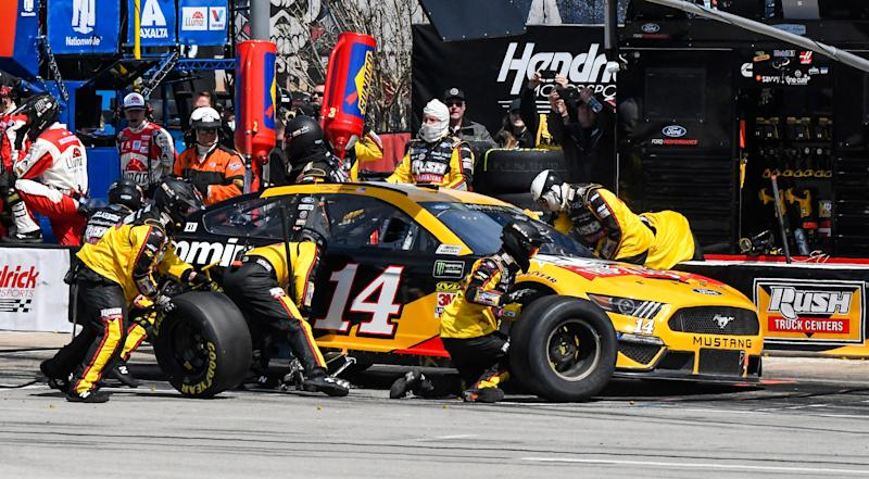 Driver Clint Bowyer's pit crew service his car during a NASCAR Cup auto race at Texas Motor Speedway, Sunday, March 31, 2019, in Fort Worth, Texas. (AP Photo/Larry Papke)