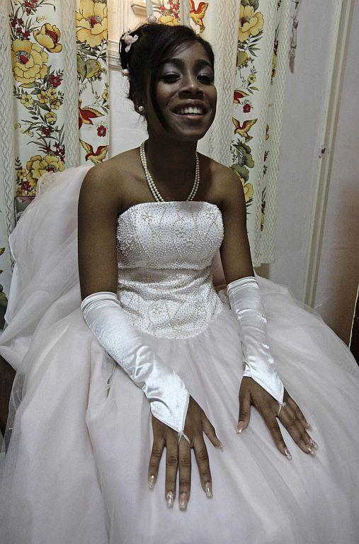 <p>Carmen Gonzalez takes a break during a photo session for her quinceanera.</p>