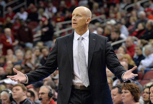 Chris Mack would rather not be answering questions about the Pitinos. (AP)