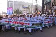 Supporters of several Islamist parties march in protest after Friday prayers in Dhaka, Bangladesh, Friday, Oct. 30, 2020. Thousands of Muslims and activists marched through streets and rallied across Bangladesh's capital on Friday against the French president's support of secular laws that deem caricatures of the Prophet Muhammad as protected under freedom of speech. (AP Photo/Mahmud Hossain Opu)