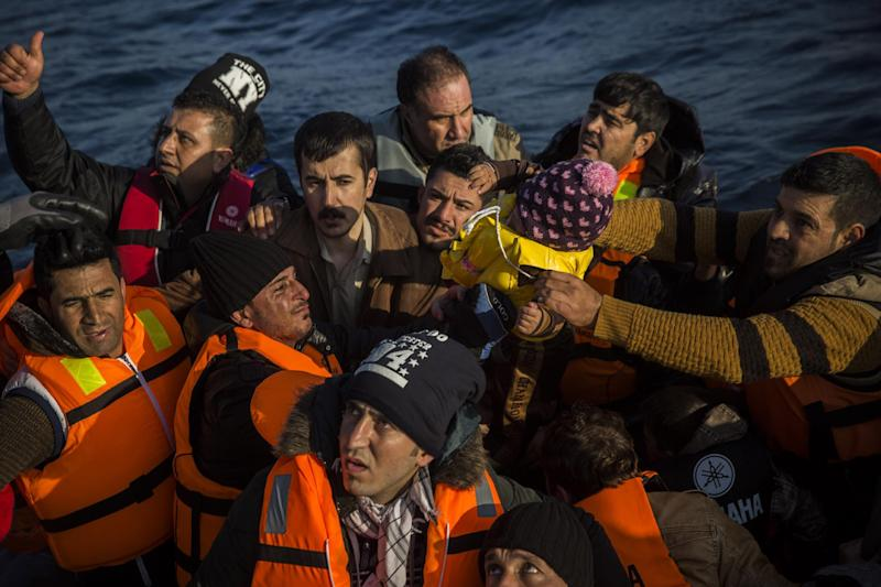 FILE - In this Dec. 8, 2015 file picture migrants, who were lost in an open sea, ask for help from members of the Frontex, European Border Protection Agency, from Portugal, as they try to approach in a dinghy the Greek island of Lesbos. The head of the European Union border control, agency Frontex, Fabrice Leggeri, said Saturday Dec. 17, 2016 that about 350,000 migrants arrived in the EU this year so far. (AP Photo/Santi Palacios)