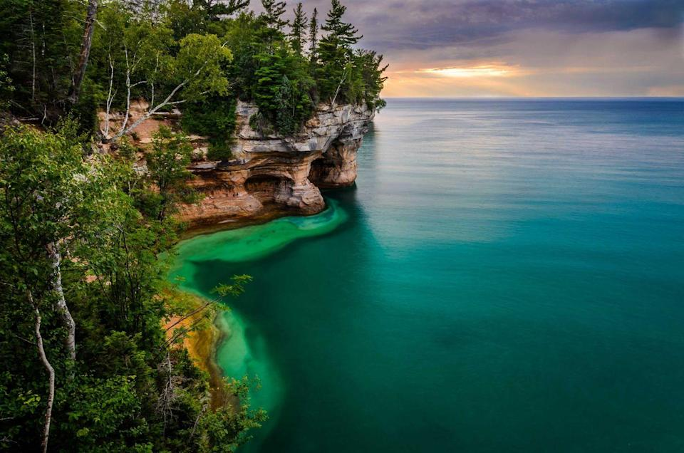 """<p><strong>Pictured Rocks National Lakeshore</strong></p><p>Along the south shore of Lake Superior in Michigan's Upper Peninsula, <a href=""""https://www.nps.gov/piro/index.htm"""" rel=""""nofollow noopener"""" target=""""_blank"""" data-ylk=""""slk:Pictured Rocks National Lakeshore"""" class=""""link rapid-noclick-resp"""">Pictured Rocks National Lakeshore</a> is known for picturesque, multicolored rock cliffs. Unusual sandstone formations define this lakeshore. Visitors can also walk through a white birch forest in Twelvemile Beach.</p>"""