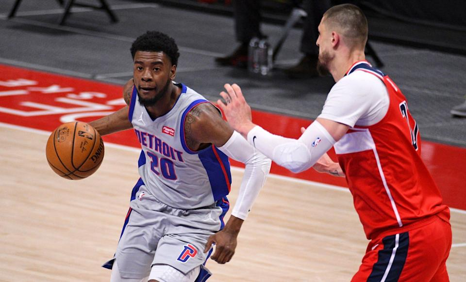 Detroit Pistons guard Josh Jackson (20) drives to the basket as Washington Wizards center Alex Len (27) defends during the first quarter at Little Caesars Arena on April 1, 2021.