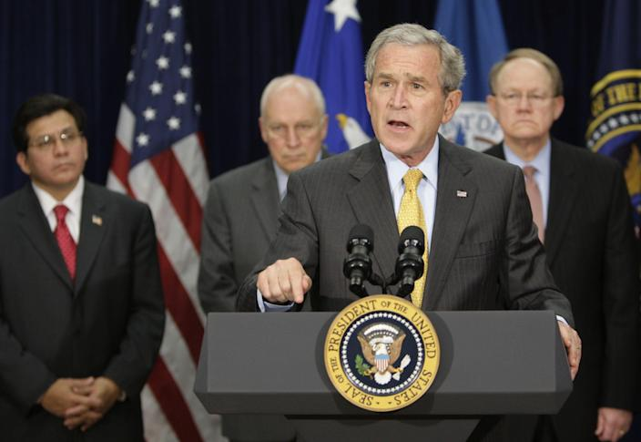 President Bush makes comments after meeting with the Counterterrorism Team at the J. Edgar Hoover FBI Building in Washington in 2007. Behind the president, from left are, Attorney General Alberto Gonzales, Vice President Dick Cheney, Admiral Mike McConnell, director of National Intelligence. (Photo: Ron Edmonds/AP)