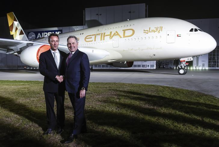 Bregier, CEO of Airbus and Hogan, CEO of Etihad Airways, shakes hands in front of an Airbus A380 during the branding ceremony of Etihad Airways at the German headquarter of aircraft company Airbus, in Hamburg-Finkenwerder