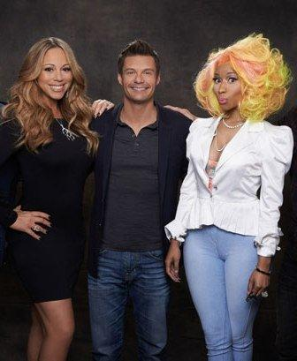 """A catfight between new American Idol judges Mariah Carey and Nicki Minaj was so anticipated that reporters made inquiries during their first press conference together. An overly optimistic Carey attempted to discourage such speculation, but she spoke too soon. Within weeks, TMZ had posted a video of Nicki's expletive-filled tirade against Carey, who Nicki referred to as """"her f—king highness."""" In an untelevised phone interview with The View host Barbara Walters, Carey confirmed that Nicki threatened her. According to Walters, Carey said a number of witnesses heard Nicki say, """"If I had a gun, I would shoot the b-tch"""" as she walked off the set. Carey said she and Nicki have since had meetings with the producers in an effort to make amends. Carey told Walters that while Nicki did not apologize, she told Carey that she loved her but could not promise that they would not have arguments in the future. A concerned Carey said she plans to stay on the show, but has hired increased security. According to TMZ, Carey's conversation with Walters added more fuel to Nicki's fury, prompting her to post the following tweet that has since been deleted: """"I don't call tmz n Barbara Walters cuz I stand on my own two feet. Never needed an army. God is good. Insecurity is as cruel as the grave."""" Nicki also added, """"I thought we resolved it yesterday but I see u want ur pity party to continue. So I'm bout to po dot tea,"""" Nicki wrote on her Twitter page."""