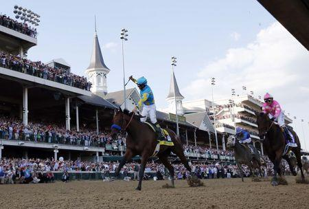 FILE PHOTO - May 2, 2015; Louisville, KY, USA; Victor Espinoza aboard American Pharoah celebrates winning the 141st Kentucky Derby at Churchill Downs. Mandatory Credit: Brian Spurlock-USA TODAY Sports