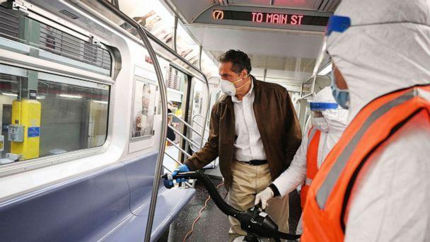 PHOTO: Governor Andrew M. Cuomo, New York Gov. Cuomo tries out a spraying device which is part of a three-step disinfecting process of a New York City subway car at the Corona Maintenance Facility in Queens, New York, on Saturday, May 2, 2020. (Kevin P. Coughlin/AP)