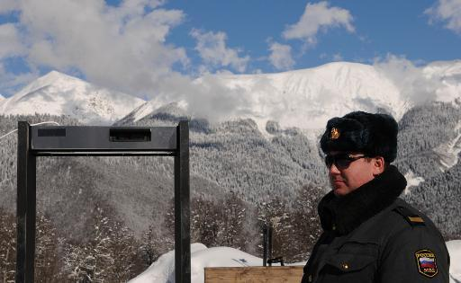 This file photo shows a police officer standing near a metal detector frame at the Gornaya Karusel (Mountain Carousel) sports and holiday complex, that will be used at the 2014 Winter Olympics, in Sochi, on February 11, 2011