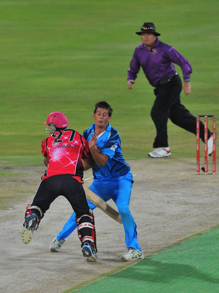 PRETORIA, SOUTH AFRICA - OCTOBER 26: (SOUTH AFRICA OUT) CJ de Villiers of Nashua Titans collides with Pat Cummins of Sydney Sixers as he makes the single run needed for victory during the Karbonn Smart CLT20 Semi Final match between Nashua Titans and Sydney Sixers at SuperSport Park on October 26, 2012 in Pretoria, South Africa. (Photo by Duif du Toit/Gallo Images/Getty Images)