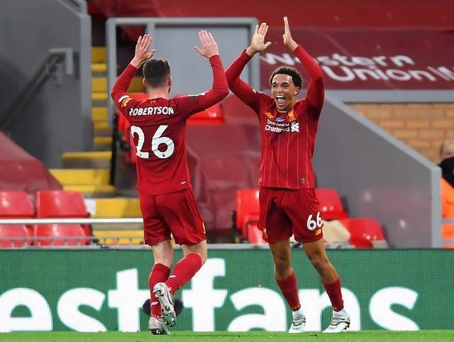 Andy Robertson and Trent Alexander-Arnold celebrate on the pitch