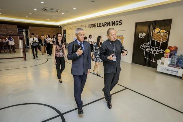 Kraikruan (left) and Lee (right) on a walkabout of the Genovasi Design Thinking School at Redberry City in Petaling Jaya during the former's visit. ― Picture by Firdaus Latif