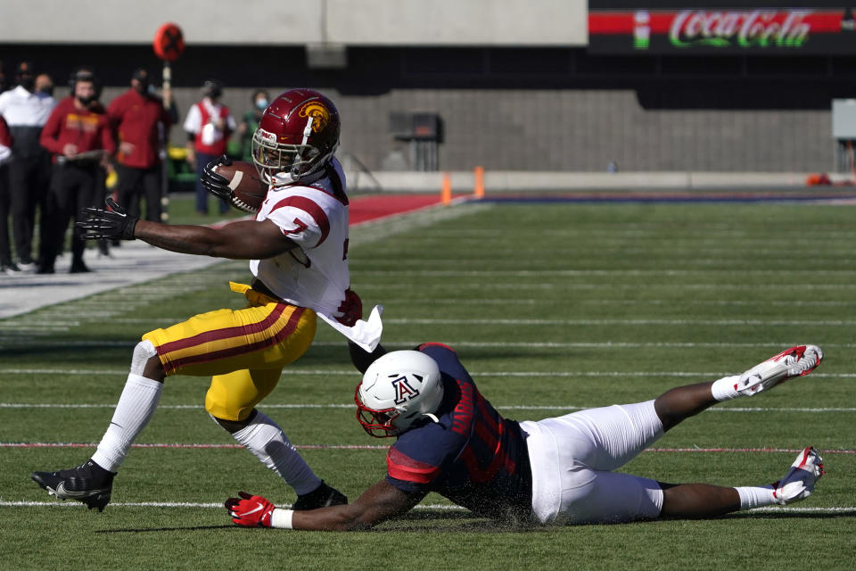 Arizona linebacker Jalen Harris (49) tackles Southern California running back Stephen Carr (7) in the first half during an NCAA college football game, Saturday, Nov. 14, 2020, in Tucson, Ariz. (AP Photo/Rick Scuteri)