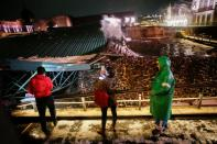 """Personnel of the Minister of Culture observe the damage of the roof protecting the """"Casa de las Aguilas"""", part of the ruins of the Templo Mayor archaeological site, which collapsed after heavy rain and hail, in Mexico City"""