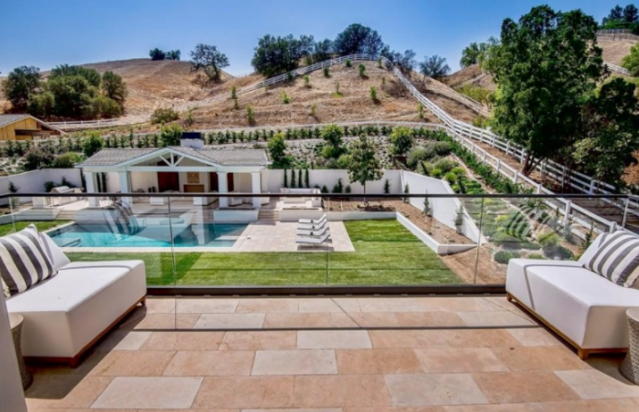 Stunning view of pool and hills from patio. (Photo: Trulia)