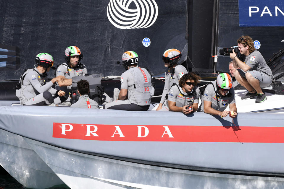 Italy's Luna Rossa crew wait during a postponement of race 7 against Team New Zealand in the America's Cup on Auckland's Waitemata Harbour, New Zealand, Sunday, March 14, 2021. (Chris Cameron/Photosport via AP)