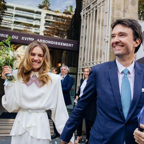 """<p>The supermodel married philanthropist Arnault and shared a picture of herself and her new husband walking out of the registry office on Monday September 21.</p><p>The star wore an ivory-coloured collared Ulyana Sergeenko Couture dress with padded shoulders and a belted. The dress featured sweet hand-stitched embroidery in fuchsia and was teamed with ivory-hued court shoes.</p><p>'OUI,' she captioned the photograph and video of her leaving the registry office. </p><p><a href=""""https://www.instagram.com/p/CFZzsOND0mk/"""" rel=""""nofollow noopener"""" target=""""_blank"""" data-ylk=""""slk:See the original post on Instagram"""" class=""""link rapid-noclick-resp"""">See the original post on Instagram</a></p>"""