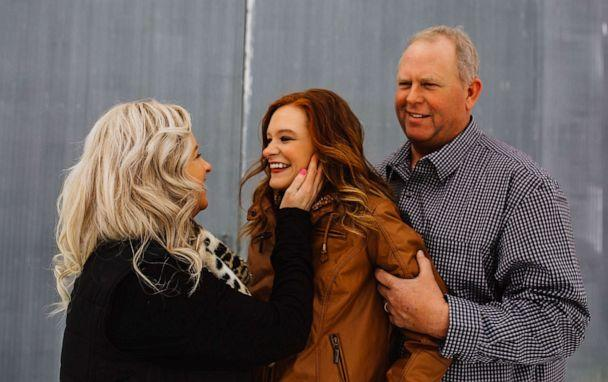 PHOTO: Jaci Hermstad, 25, is pictured with her parents, Lori and Jeff, in Webb, Iowa, March 2019. (Harvest Moon Photography)